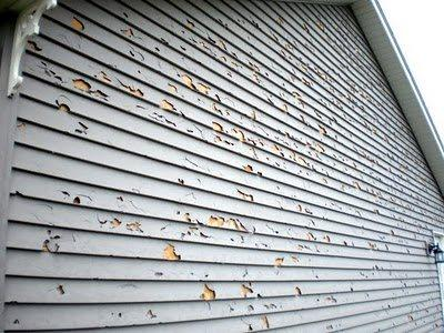 This is the result of hail damage to siding.
